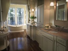 This romantic, neutral master bathroom from HGTV Dream Home 2009 is a feast for the eyes. At the end of the long, narrow room sits a grand Victorian-style tub, offset by gleaming hardwood floors. Custom cabinetry offers ample room for double vanities and plenty of storage.