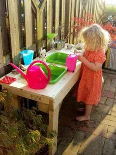 Outdoor play kitchen/water table) - find a table, cut two holes - insert plastic tubs./ If you don't have a water table , make one! Outdoor Play Kitchen, Kids Outdoor Play, Mud Kitchen, Outdoor Fun, Kitchen Sinks, Backyard Kitchen, Backyard Play, Outdoor Playground, Outdoor Playhouse For Kids