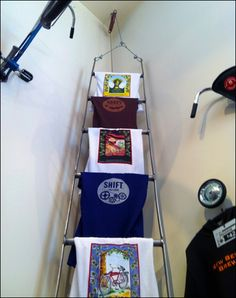 Laddered T-Shirt Merchandising-  Use 1 of our old wooden ladders for logo wear?