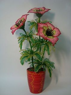 Interesting idea; as I did with the anthurium stamen, wrap beads around ends of petals to cover wire and such.