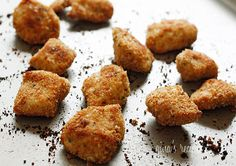 Healthy Baked Chicken Nuggets | Skinnytaste.  16 oz (2 large) skinless boneless chicken breasts, cut into even bit sized pieces. salt and pepper to taste. 2 tsp olive oil (coconut instead?). 6 tbsp whole wheat Italian seasoned breadcrumbs (almond meal?). 2 tbsp panko. 2 tbsp grated parmesan cheese.