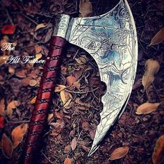 """Blackguard Customs own design of the """"All Father"""" Viking Battle Axe. Hand engraved metal and custom wood carving."""