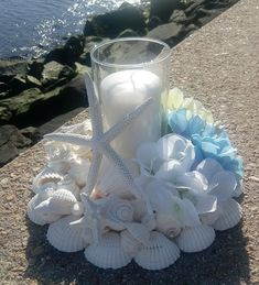 Beach Wedding Centerpiece - Beach Decor - White Shell Wreath With Candle And Silk Flowers [ Beach Wedding Centerpiece Beach Decor White Shell Wreath image Bridal Party Tables, Beach Wedding Centerpieces, Seashell Crafts, Sea Crafts, Seashell Art, Diy Birthday Gifts For Friends, Barn Weddings, Destination Weddings, Romantic Weddings