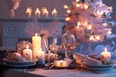 White Christmas table set up with candles, wine glasses of different shapes and sizes, tableware, etc. Christmas Table Settings, Christmas Tablescapes, Christmas Table Decorations, Decoration Table, Tree Decorations, Holiday Tablescape, Christmas Kitchen, White Christmas, Christmas Lights