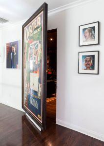 Passage Hidden Behind Large Art Work