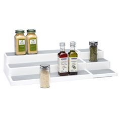 I love this multi-level rack from The Container Store.  I would use it in my pantry, my spice cabinet, my medicine cabinet, etc.  So useful!!  JRD.
