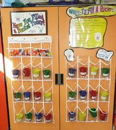 """Love this idea, with clear cups/buckets. Students earn a pom pom in their bucket for good behavior/encouraging one another and can share when another student """"filled their bucket."""" They can earn rewards such as bringing a stuffed animal to school, taking off shoes at reading time, extra free time, etc."""
