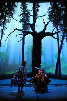 I love the trees and the lighting techniques.  This forest has an unbelievable depth.     From Falstaff, performed in Metz, France, 2007 - Opera