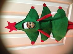 Herbie, our Elf on the Shelf, got his own Christmas Tree Costume!   All you need is felt and some sewing skills.  Thanks Mom! Elf on the Shelf