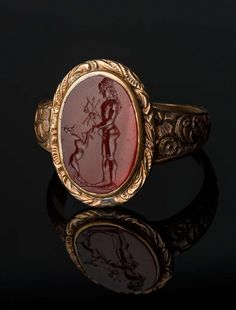 Oval carnelian gem with Apollo and a young deer, intaglio, set in a 1912-13 more modern ring. Roman, Republican Period, 2nd–1st century B.C. | Museum of Fine Arts, Boston