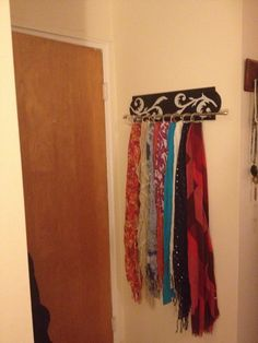 DIY scarf holder! Attach a curtain rod to a painted board and hang your scarves on shower curtain rings.