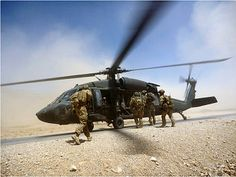 Australian soldiers from the Special Operations Task Group board a U.S. Army Black Hawk helicopter after a mission in Uruzgan province, southern Afghanistan