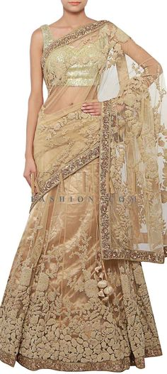 Buy Online from the link below. We ship worldwide (Free Shipping over US$100) http://www.kalkifashion.com/beige-lehenga-saree-adorn-in-thread-and-pearl-embroidery-only-on-kalki.html
