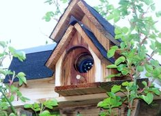 Hides security camera but can become a bird house or yard decor