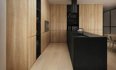 P-house by Tamizo Architects Group. Timber Cupboards, Black Island Bench