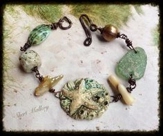Been to the beach lately? I used my porcelain starfish pendant and bead, bleached coral, Roman glass, pearls, shell, and twisted copper clasp.