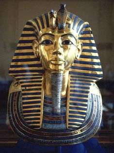 Death Mask of Tutankhamun. The death mask of Egyptian pharaoh Tutankhamun is made of gold inlaid with colored glass and semiprecious stone. The mask comes from the innermost mummy case in the pharaoh's tomb