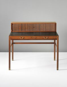 Brass feet. Ole Wanscher; Rosewood, Leather and Brass Writing Desk for A.J. Iversen, c1945.