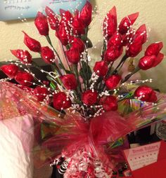 Hershey Roses-Bouquet is made from Hershey kisses, floral wire, pearl sprays, silk leaves and red cellophane wrapped with floral tape. (Sacramento, CA)