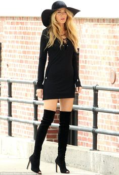 The thigh's the limit: The star then turned Seventies siren and wriggled into thigh high black suede boots