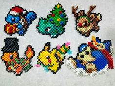 This set of 6 custom-designed Christmas themed Pokemon perlers are perfect for decorating your christmas tree or home this year! This set comes complete with Christmas Tree Bulbasuar, Rudolph the Red Nosed Eevee, Ebeneezer Charmander, Snowlax, Santa Squirtle, and a special glow in the dark Christmas light Pikachu! All ornaments come with hooks to hang on your tree!  To purchase ornaments individually, see here: https://www.etsy.com/listing/492455781/pokemon-christmas-ornaments-a-la