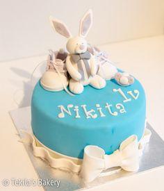 Turqoise fondant cake with bunny, shoes and baby stuff www.tekila.fi