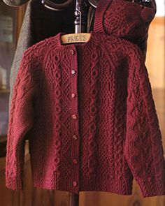 Japanese knitting pattern for cabled sweater. Love the collar finishing.