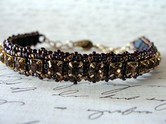 Shades of purple and gold. 4mm cup chain bracelet.