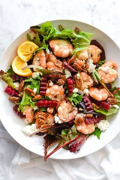 Sweet glazed pecans, roasted beets and goat cheese are added to fresh grilled shrimp over fresh spring lettuces to create a healthy meal in one bowl. Beet And Goat Cheese, Goat Cheese Salad, Glazed Pecans, Shrimp Salad, Grilled Shrimp, Clean Eating, Healthy Eating, Cheese Ingredients, Winter Salad