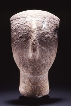 Head of a Cycladic figurine with traces of colour [marble]. Early Cycladic II period (2800-2300 B.C.).