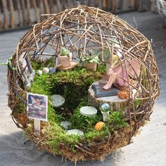 Fairy garden inside a small sphere.