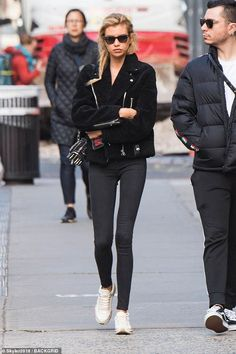 Stella paired her skimpy top with a furry coat and chunky, white sneakers. She carried her belongings in a studded belt bag and accessorized with black wayfarer shades. Female Models, Women Models, Stella Maxwell, Models Off Duty, Coats For Women, Fashion Models, Black Women, What To Wear, Street Style