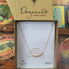 "Dogeared Balance Necklace. Price firm. Balance-a happy life is not built upon the goal of perfection, but balance. This beautiful symbolic Dogeared Balance smooth gold bar necklace is the perfect accessory for everyday outfit. This petite necklace features a 14k gold dipped bar on an 18"" gold plated sterling silver chain. Spring clasp closure. Dogeared Jewelry Necklaces"