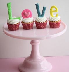 Sweetopia's Love Cupcakes: Sweetopia's love cupcakes take a simple cupcake up a notch with edible disco-dust-topped fondant letters.  Source: Sweetopia