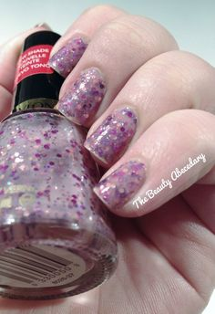 Girly by Revlon, a cute glitter bomb polish in a milky base. #glitter #glitterbomb #revlon #girly #nailpolish