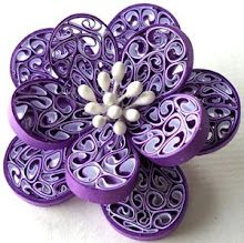 "purple pin ..... This doesn't have a ""how to"" link but it looks like it is made of thin ribbon.  Good luck!"