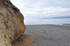 A cliff protruding onto a local Kodiak beach. Photo by: Erika Morgan