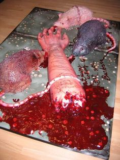 horror cake, arm cut off with rats feasting