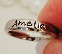 Check out this item in my Etsy shop https://www.etsy.com/listing/163926194/name-ring-personalized-stacking-ring