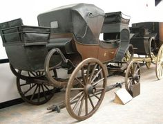 """Britzschka """"This carriage reputedly travelled from Chester to Rome and back in the early 19th century. The name comes from the Polish word for travelling wagon. This type of carriage was introduced to Britain via Germany in the 1820s and was popular with wealthy families because of their adaptability. It has many similar features to the Travelling Barouche apart from the body shape. It has the useful addition of a silk sun visor and a large boot for luggage."""""""