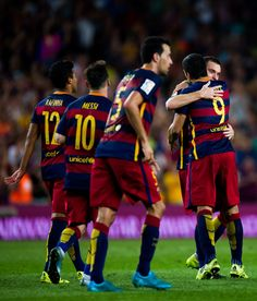 Thomas Vermaelen (2nd R) of FC Barcelona is congratulated by his temmate Luis Suarez after scoring the opening goal during the La Liga match between FC Barcelona and Malaga CF at Camp Nou on August 29, 2015 in Barcelona, Catalonia.