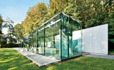 belgian modern glass pavilion//house roces by govaert and vanhoutte architects in bruges, belgium