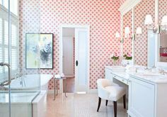"A wall of ""Mardale"" red floral wallpaper by Cowtan & Tout enlivens the otherwise neutral master bath. - Traditional Home ® / Photo: Gordon Beall / Design: Dee Elms and Andrew Terrat"