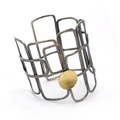 "Paulette Werger: Structure Cuff, Oxidized sterling silver, and 18k yellow gold. Approx 2 1/2"" wide."