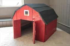 DIY Pallet Toy Barn with Chalkboard Roof for outdoor toy parking/storage