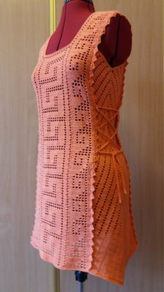 The orange tunic is knitted from a cotton yarn. Soft and fine natural yarn. Incredibly beautiful crocheted tunic for summer and beach. Straight style. It has ties to the sides. Ideal for hot summer. Size S-M (UK 10, EURO 38). Dummy dimensions on a photo: chest girth - 88 cm (34 inch), waist circumference - 70 cm (27 inch)  Hand wash in cold water, not wring out and lay out to dry.  Prepared to ship.  Thank you for your time and welcome back!  Additional Information -Colors may vary depending…