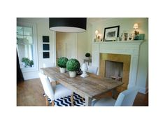 Lovely Dining Rooms with Rustic Reclaimed Dining Table, Black Drum Shade Pendant, Traditional Fireplace Mantel, Topiary Centerpiece, Black and White Chevron Rug