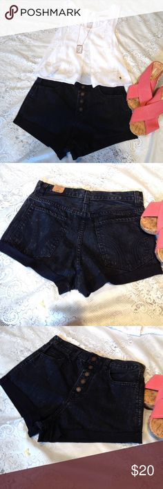 "High waisted shorts Dark blue/black denim high waisted shorts with front and back pockets and 5 working buttons. ""High Rise Festival Short"" with 26W. Ends are sew folded up and frayed purposefully. NWOT. PRICE FIRM, NO TRADES. Hollister Shorts Jean Shorts"