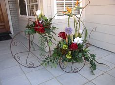 Garden designs can be a favorite to create.  This lady was tired of taking care of fresh units, so this became her porch focal.  Very French Country...