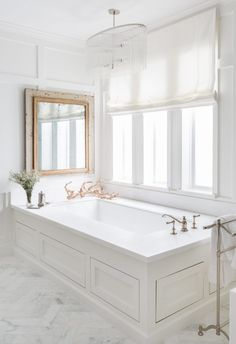 Marie Flanigan Interiors - Lighting Roundup - Royalton Oval Pendant from Arteriors - White and Grey Master Bathroom - Soaking Tub with Chandelier